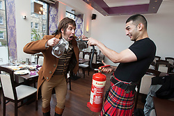 Robert Burns lookalike Chris Tait samples controversial.restaurant Kismot's new Burn's Day haggis curry, with Abdul Ali from Kismot. After the killer curry..Pic © Michael Schofield...