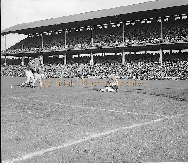 Offaly goalie catches the ball as he slides to the ground the All Ireland Senior Gaelic Football Final Kerry v Offaly in Croke Park on 28th September 1969. Kerry 0-10 Offaly 0-7.