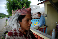 """MEXICO, Veracruz, Tantoyuca, Oct 27- Nov 4, 2009. A young dancer waits for an audience in Chicontepec. """"Xantolo,"""" the Nahuatl word for """"Santos,"""" or holy, marks a week-long period during which the whole Huasteca region of northern Veracruz state prepares for """"Dia de los Muertos,"""" the Day of the Dead. For children on the nights of October 31st and adults on November 1st, there is costumed dancing in the streets, and a carnival atmosphere, while Mexican families also honor the yearly return of the souls of their relatives at home and in the graveyards, with flower-bedecked altars and the foods their loved ones preferred in life. Photographs for HOY by Jay Dunn."""