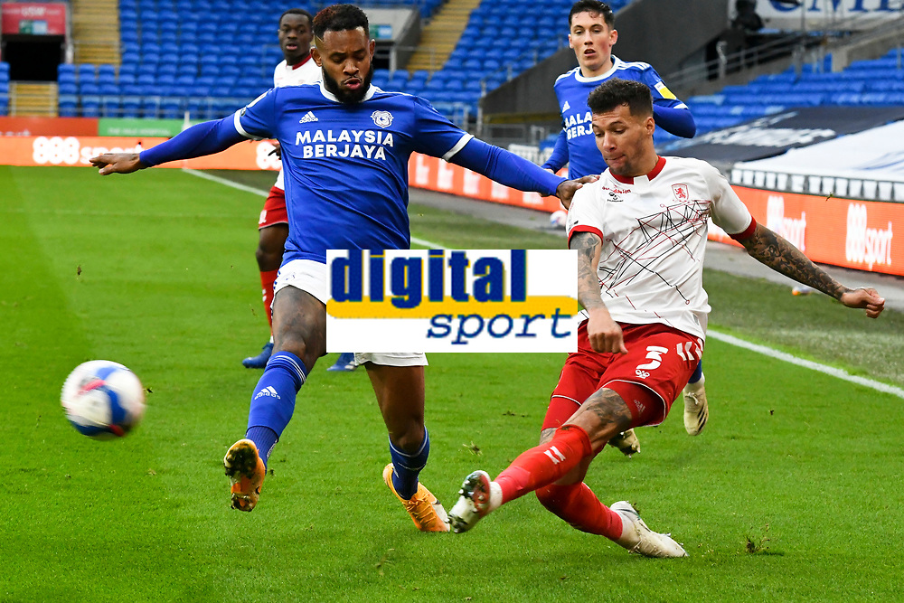 Football - 2020 / 2021 Sky Bet Championship - Cardiff City vs Middlesbrough - Cardiff City Stadium<br /> <br /> <br /> Marvin Johnson of Middlesbrough crosses the ball Gavin Whyte of Cardiff City defends  in a match played without fans<br /> <br /> COLORSPORT