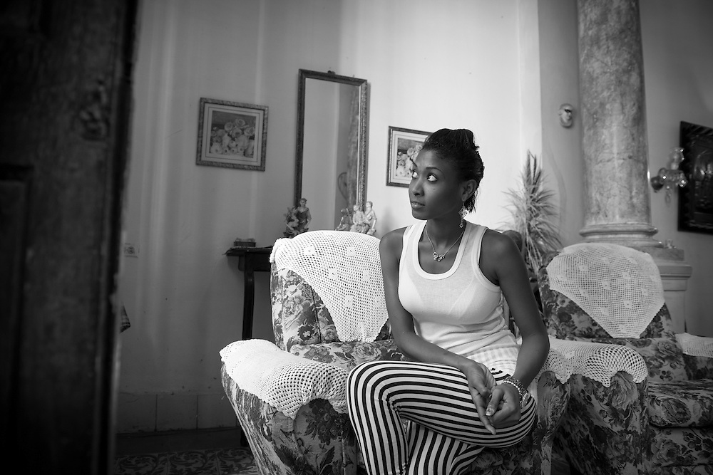 Portrait of Cuban young woman at home in Havana