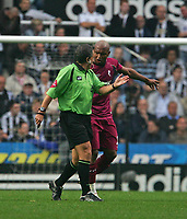 Photo: Andrew Unwin.<br /> Newcastle United v Bolton Wanderers. The Barclays Premiership. 15/10/2006.<br /> The referee, Alan Wiley (L), has words with Bolton's El-Hadji Diouf (R) following his goal celebration.