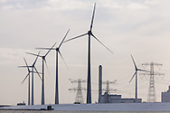 Wind turbines in the snow in Eemshaven, Netherlands