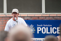 """Rotherham England<br /> 13 September 2014 <br /> March organisers speak to EDL members and Supporters outside Rotherham Main Street Police station where they held a rally as part of the English Defence Leagues """"Justice for the Rotherham 1400"""" March described by an EDL Facebook Page as """"a protest against the Pakistani Muslim grooming gangs"""" on Saturday Afternoon <br /> <br /> <br /> Image © Paul David Drabble <br /> www.pauldaviddrabble.co.uk"""