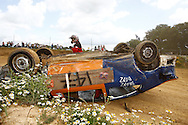 Thankfully no injuries to the driver of car 147 which inverted, narrowly missing your photographer, in the World Dirt Final during the race meeting at Smallfield Raceway, Surrey, UK on the 10th of July 2011 (photo by Andrew Tobin/SLIK images)