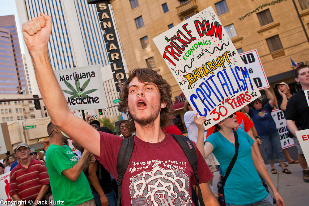 14 OCTOBER 2011 - PHOENIX, AZ:   Marchers demonstrate in front of the Chase Bank in Phoenix during the Occupy Phoenix march. About 300 people participated in the Occupy Phoenix march through downtown Phoenix Friday evening, Oct. 14. The march was the first event in the Occupy Phoenix protests which start with the occupation of Cesar Chavez Plaza, a large square in downtown Phoenix. PHOTO BY JACK KURTZ