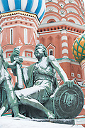 Detail of The statue of Kuzma Minin and Dmitry Pozharsky with The Cathedral of Vasily the Blessed, commonly known as Saint Basil's Cathedral, is a former church in Red Square in Moscow, Russia