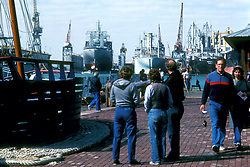 Group of people watching ships in Galveston Texas