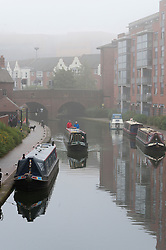 © Licensed to London News Pictures. 15/09/2016. Birmingham, West Midlands,  UK. During Birmingham Heritage Week heavy fog envelopes the canal system in the  morning ahead of a day of temperatures forecast to reach 25 deg centigade in Birmingham, West Midlands, UK. Photo credit: Graham M. Lawrence/LNP