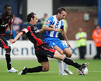 Photo: Chris Ratcliffe.<br />Colchester United v Queens Park Rangers. Coca Cola Championship. 16/09/2006.<br />Matthew Rose (L) of QPR clashes with Karl Duguid of Colchester United.