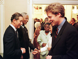 The Prince of Wales (left) talking to the the Princess of Wales's brother, Earl Spencer, following a  banquet held in Cape Town , tonight (Tuesday) where the Prince praised the charity work of his ex-wife Diana and spoke of her tragic and untimely death.