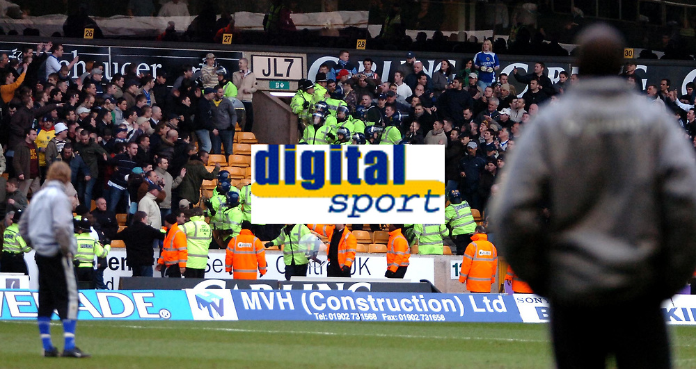 Photo: Ed Godden.<br />Wolverhampton Wanderers v Cardiff City. Coca Cola Championship. 11/03/2006. <br />Players warming up at half-time watch on a s police deal with the angry Cardiff fans.