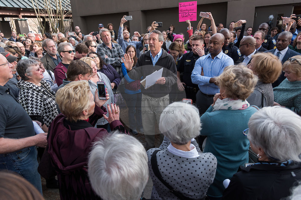 U.S. Rep. Mark Sanford, center, and U.S. Sen. Tim Scott, right, meet with constituents who could not fit into a town hall meeting to discuss holding a second meeting February 18, 2017 in Mount Pleasant, South Carolina. Hundreds of concerned residents turned up for the meeting to address their opposition to President Donald Trump during a vocal meeting.