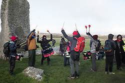 Salisbury, UK. 5th December, 2020. Samba drummers join over one hundred people, including local residents, climate and land justice activists and pagans, taking part in a Mass Trespass at Stonehenge. The trespass was organised in protest against the approval by Transport Secretary Grant Shapps of a £1.7bn project for a two-mile tunnel beneath the World Heritage Site and a further eight miles of dual carriageway for the A303, as well as the government's £27bn Road Investment Strategy 2 (RIS2).