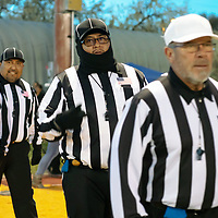 (L-R) Referees Nelson Tom, C.B Barton, Jerry Kien, and Trinidad Saucedo step onto the field for the Friday night game between the Zuni Thunderbirds and Thoreau Hawks in Thoreau.