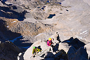 Climbers on the northeast ridge of  Bear Creek Spire, John Muir Wilderness, Sierra Nevada Mountains, California