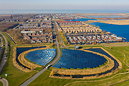 Nederland, Almere, 20190227<br /> Zoneiland, een eiland met zonnecollectoren die water verwarmen voor het verwarmen van de woningen in de wijk erachter. <br /> <br /> Foto (c) Michiel Wijnbergh