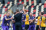 RED CARD Today's referee Thomas Bramall shows the red card to Tranmere Rover's Paul Lewis (22) during the EFL Sky Bet League 2 match between Newport County and Tranmere Rovers at Rodney Parade, Newport, Wales on 17 October 2020.