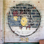 WW2 emblem painting at the former Flixton air force base in Suffolk, England. Flixton was a former airfield located around 3 miles (4.8 km) south-west of Bungay and home  to the 706th Bombardment Squadron, an operational squadrons of the 446th Bombardment Group (Heavy). The 446th operated chiefly against strategic objectives on the Continent from December 1943 until April 1945. Targets included U-boat installations at Kiel, the port at Bremen, a chemical plant at Ludwigshafen, ball-bearing works at Berlin, aero-engine plants at Rostock, aircraft factories at Munich, marshalling yards at Coblenz, motor works at Ulm, and oil refineries at Hamburg. After the war, the buildings reverted to agricultural and industrial use.