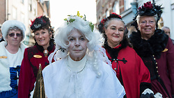 © Licensed to London News Pictures. 03/12/2016. Rochester, UK. A woman dressed as Miss Havisham from Great Expectations lead participants taking part in the Rochester Dickensian Christmas Festival.  The Kent town is given a Victorian makeover to celebrate the life of the writer Charles Dickens (who spent much of his life there), with Victorian themed street entertainment, costumed parades and a Christmas market. Photo credit : Stephen Chung/LNP
