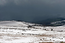 © Licensed to London News Pictures. 04/04/2019. Builth Wells, Powys, Wales, UK. Wild wintry landscape is seen as showers of snow, sleet and hail continue on the Mynydd Epynt range between Builth Wells and Brecon in Powys, UK. Photo credit: Graham M. Lawrence/LNP