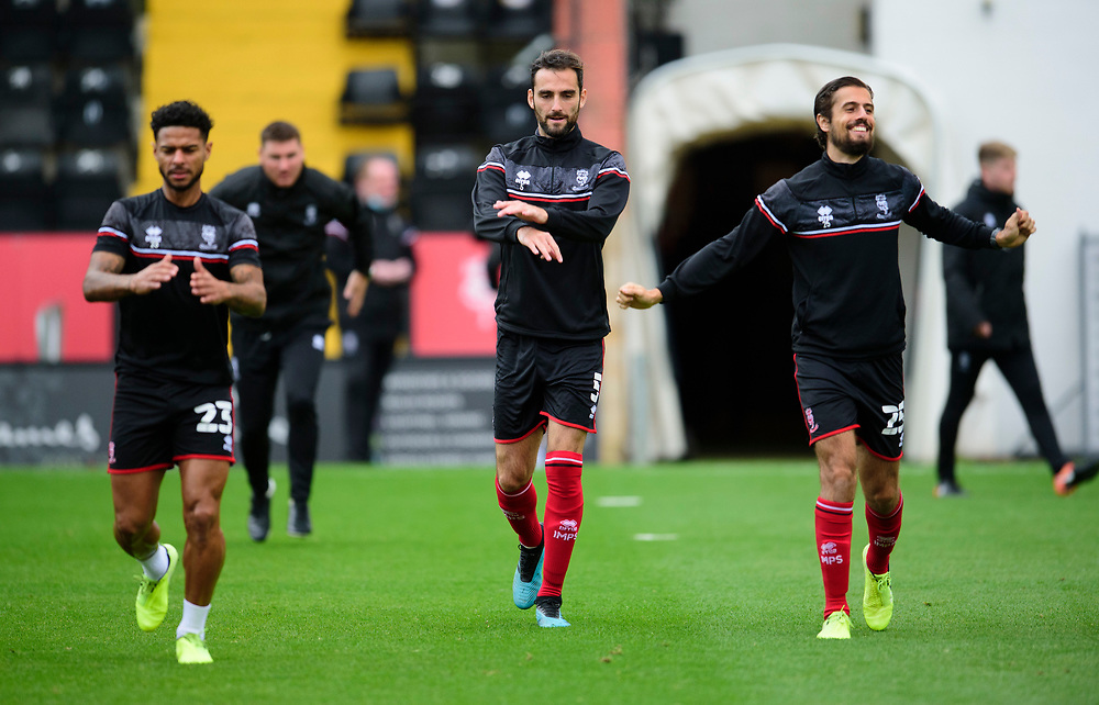 (left to right) Lincoln City's Liam Bridcutt, Adam Jackson and Zack Elbouzedi during the pre-match warm-up<br /> <br /> Photographer Andrew Vaughan/CameraSport<br /> <br /> The EFL Sky Bet League One - Lincoln City v Charlton Athletic - Sunday 27th September, 2020 - LNER Stadium - Lincoln<br /> <br /> World Copyright © 2020 CameraSport. All rights reserved. 43 Linden Ave. Countesthorpe. Leicester. England. LE8 5PG - Tel: +44 (0) 116 277 4147 - admin@camerasport.com - www.camerasport.com