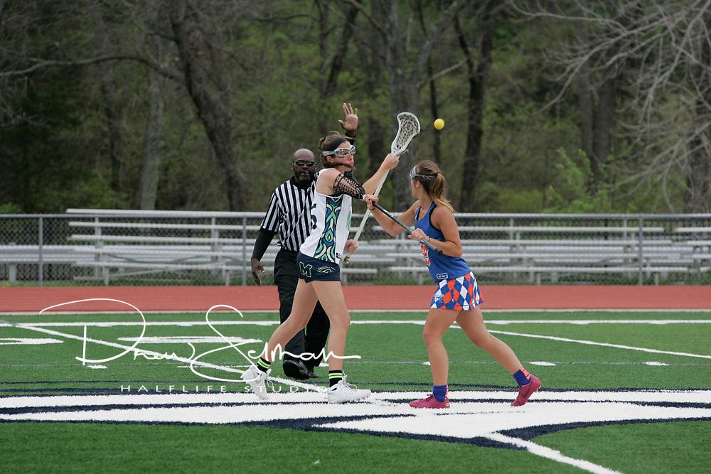 MHS Girls Varsity Lacrosse takes Clayton HS, 14-9 in their home opener.