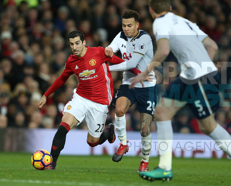 Henrikh Mkhitaryan of Manchester United held back by Dele Alli of Tottenham during the English Premier League match at Old Trafford Stadium, Manchester. Picture date: December 11th, 2016. Pic Simon Bellis/Sportimage