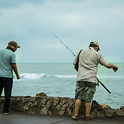 Early morning anglers trying their luck in the Old City, Cartagena, Colombia.