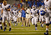 Kentucky Wildcats head coach Joker Phillips is interview as he leaves the field during a rain delay in the first half of a game against the Arkansas Razorbacks at Donald W. Reynolds Razorback Stadium in Fayetteville, Ark., on Oct.. 13, 2012. Photo by Beth Hall