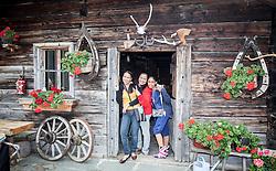 THEMENBILD, Arabische Gäste bei einem Ausflug auf die Fürthermoar Alm bei den Hochgebirgsstauseen Kaprun, Angestellte und eine junge araberin vor einer Almhütte. Jedes Jahr besuchen mehrere Tausend Gäste aus dem arabischen Raum die Urlaubsregion im Salzburger Pinzgau, aufgenommen am 29.08.2013 in Kaprun, Österreich // Arab guests at a trip to the Fuerthermoar Alm at the Kaprun Alpine Reservoirs. Every year thousands of guests from Arab countries takes their holiday in Zell am See - Kaprun Region, Kaprun, Austria on 2013/08/29. EXPA Pictures © 2013, PhotoCredit: EXPA/ JFK