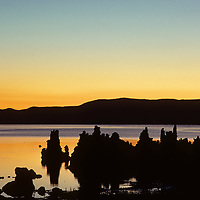 Dawn light glows over California's Mono Lake and tufa towers that were exposed by Los Angeles water diversions (LA has subsequently refilled part of the water level.)