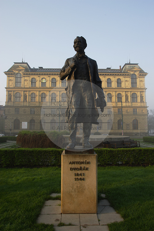 Composer Antonin Dvorak statue in front of Rudolfinum, concert hall and home of  the Czech Philharmonic at Jan Palach Square in Prague, Czech Republic.