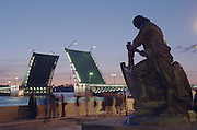 Saint Petersburg, Russia, June 2002..A statue of Peter the Great building his first boat overlooks people gathered to watch Palace Bridge raise at 2 am for the night shipping during the summer weeks known as White Nights.