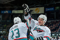 KELOWNA, CANADA - MARCH 11:  Justin Kirkland #23 and Calvin Thurkauf #27 of Kelowna Rockets high five after scoring the first goal against the Kamloops Blazers on March 11, 2016 at Prospera Place in Kelowna, British Columbia, Canada.  (Photo by Marissa Baecker/Shoot the Breeze)  *** Local Caption *** Justin Kirkland; Calvin Thurkauf;