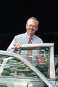 Kenneth Starr, the independent prosecutor investigating President Clinton's affair with former White House intern Monica Lewinsky gets into his car July 23, 1998 at his home in McClean, VA. Starr has agreed to grant immunity to Lewinsky in return for her cooperation in the investigation.