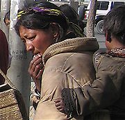 woman and child outside at a market in downtown lhasa tibet