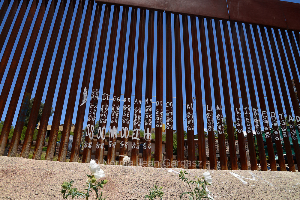 A wall indicates the international border with Nogales, Arizona, USA, as seen from Nogales, Sonora, Mexico.