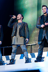 © Licensed to London News Pictures. 23/05/2012. London, UK. Westlife perform live at The O2 Arena, London, as part of their final ever farewell tour.   Westlife are an Irish boy band formed in 1998. They are to disband in 2012 after their farewell tour. The group's line-up was Shane Filan, Mark Feehily, Nicky Byrne, and Kian Egan.  In this picture L to R - Shane Filan, Mark Feehily.  Westlife have sold over 45 million records worldwide which includes studio albums, singles, video release, and compilation albums.  Photo credit : Richard Isaac/LNP