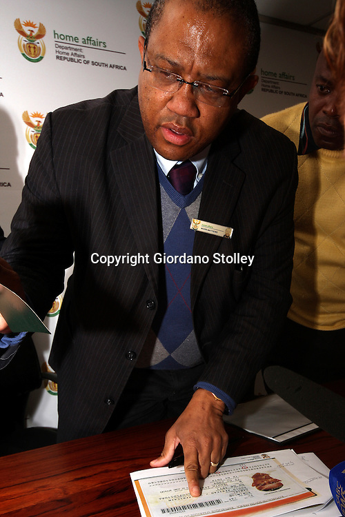 PRETORIA -- June 15, 2011 --Modiri Matthews, the chief director of the immigration inspectorate within the South Africa's Department of Home Affairs points out some of the differences on a copy of the fake passport that was found of the body of Fazul Abdullah Muhammad, the alleged Al Qaeda mastermind of the US embassy bomings..Picture: Giordano Stolley/APP Allied Picture Press