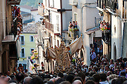 """The Holy mother is brought by the people of Guardia Sanframondi untill the entrance of the church. Every seven years in August  in a small village named Guardia Sanframondi , a one-week long catholic procession, the """"Riti Settennali"""" takes place. <br /> From Monday to Friday the flagellant walk in the street of the medieval village striking their back with small strips of metal to honour the Assumption of the Virgin Mary. The last day, Sunday, the Virgin Mary from the main church is carried around the village and venerated by the """"Battenti"""". The """"Battenti"""" are men that decide to commemorate the Assumption of the Virgin Mary beating their own chest with a cylindrical peace of cork pierced with needles (between 25 and 45)."""