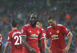 21 October 2017 Huddersfield: Premier League Football: Huddersfield Town v Manchester United: Romelu Lukaku and his United colleagues look miserable in the rain.<br /> Photo: Mark Leech