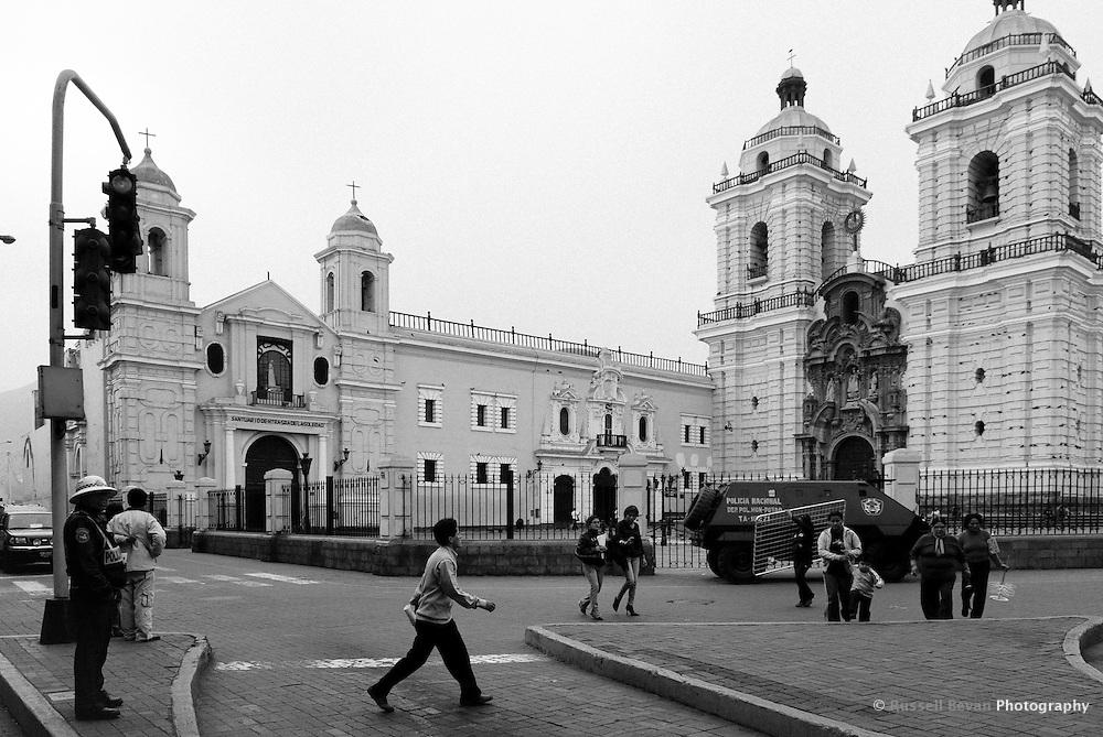 Wide shot street scene outside Saint Francis Monastery in Lima, Peru
