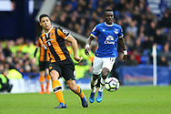 Curtis Davies of Hull City passes the ball back while under pressure from Idrissa Gueye of Everton. Premier league match, Everton v Hull city at Goodison Park in Liverpool, Merseyside on Saturday 18th March 2017.<br /> pic by Chris Stading, Andrew Orchard sports photography.