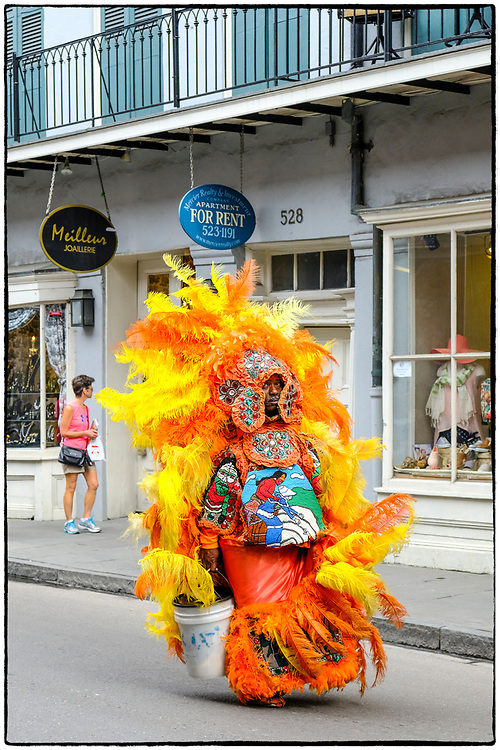 A Mardi Gras Indian takes a stroll down Royal St in The French Quarter.