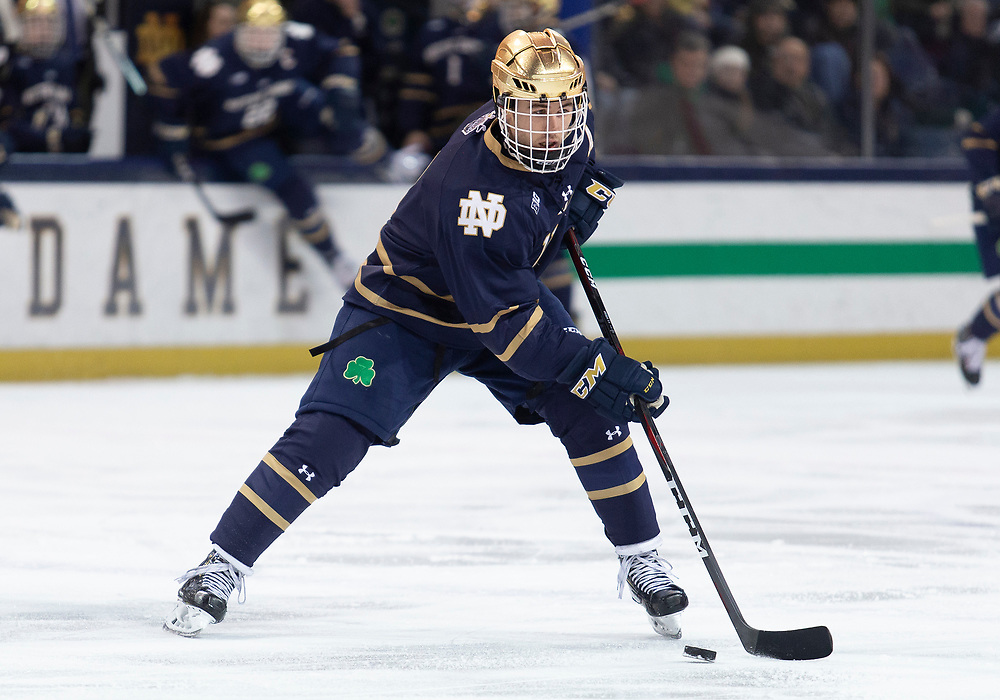 March 01, 2019:  Notre Dame forward Cal Burke (11) skates with the puck during NCAA Hockey game action between the Penn State Nittany Lions and the Notre Dame Fighting Irish at Compton Family Ice Arena in South Bend, Indiana.  Notre Dame defeated Penn State 5-4 in overtime.  John Mersits/CSM