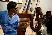 Nurse Cécile Aka Ahoua speaks to patients at the NDA health center in Dimbokro, Cote d'Ivoire on Friday June 19, 2009.