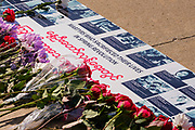06 MARCH 2021 - DES MOINES, IOWA: Flowers on a memorial in Des Moines for people killed during anti-coup protests in Myanmar. About 300 members of the Burmese community in Iowa gathered at the State Capitol in Des Moines Saturday to protest against the military coup that deposed the popularly elected government of Aung San Suu Kyi and continuing military oppression in Myanmar. There are about 10,000 people in Iowa's Burmese community.         PHOTO BY JACK KURTZ