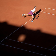 PARIS, FRANCE June 13.   Stefanos Tsitsipas of Greece serving during his match against Novak Djokovic of Serbia as the early evening shadows creep across Court Philippe-Chatrier during the Men's Singles Final at the 2021 French Open Tennis Tournament at Roland Garros on June 13th 2021 in Paris, France. (Photo by Tim Clayton/Corbis via Getty Images)