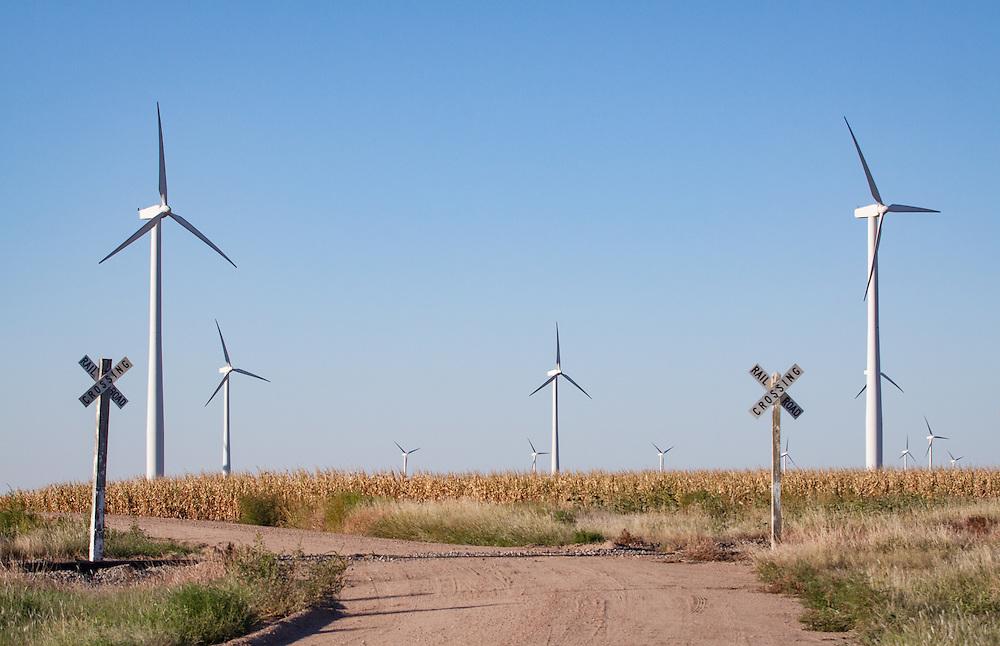 Windmills dot the praire in groups of wind farms near Montezuma, KS.